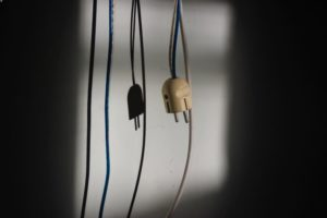 A plug hanging from its cord