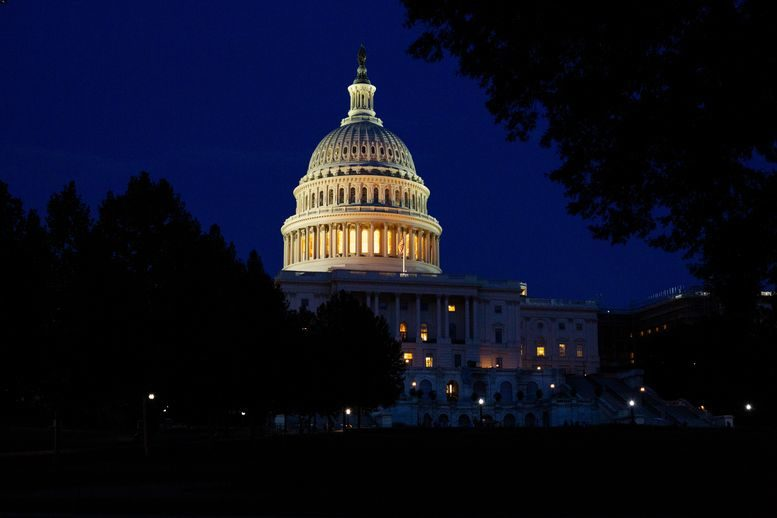 The United States Capitol at night.